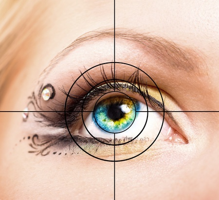 Close up Colourful human eye with makeup and target photo
