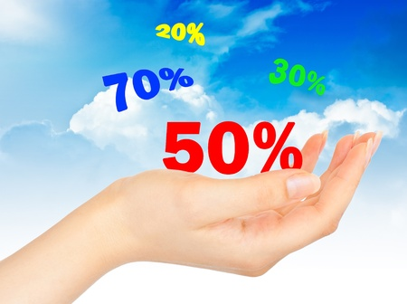 discount coupon: Flying Sale numbers on hand on blue sky background Stock Photo