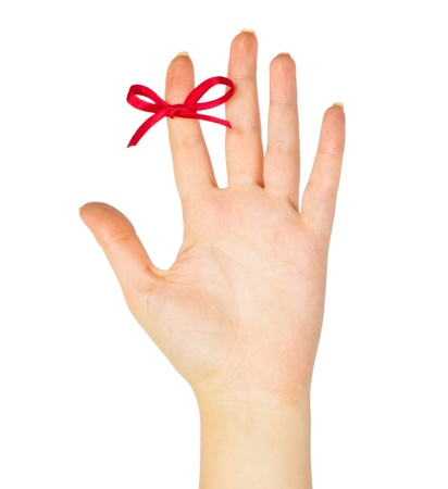finger bow: Red bow on finger isolated on white background Stock Photo