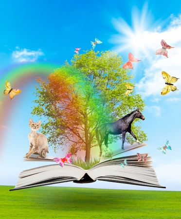 wisdom: Magic book with a green tree and diferent animals on the background of nature. Symbol of knowledge.