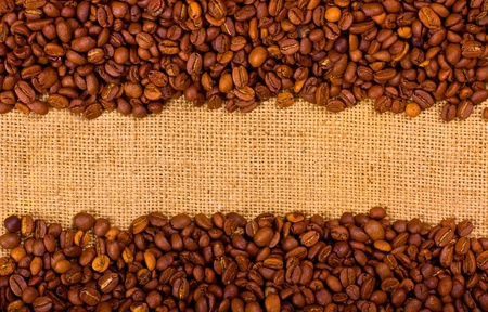 clr: Coffee grains on the burlap background with copy space Stock Photo
