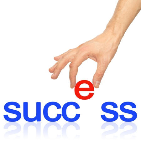 Hand and word Success - business concept. Isolated on white background Standard-Bild