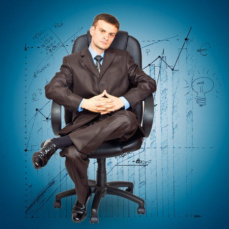 Portrait of young businessman sitting on chair against graph background Stock Photo - 11042492