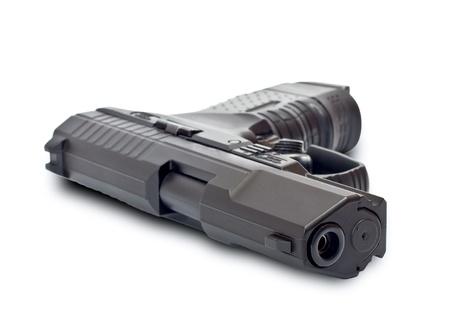 arsenal: Black gun lying on a white background Stock Photo