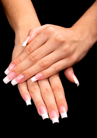 Beautiful hands with french manicure on black background photo
