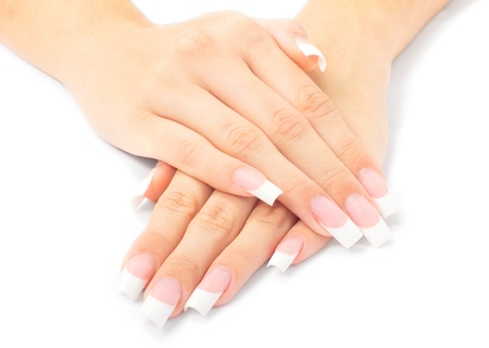 Beautiful woman hands with french manicure on white background. Standard-Bild