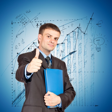 Young Businessmen making his thumb up saying OK and with folder in other hand on graph background Stock Photo - 11266913