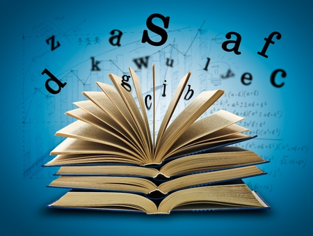 The Magic Book and the letters on a dark background with formula. Education concept Stock Photo