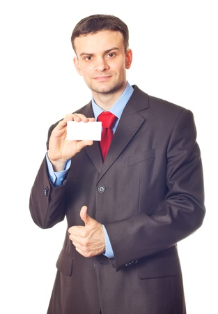 handing over: Businessman handing a blank business card over white background