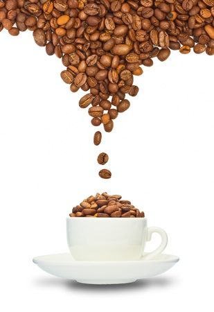Cup with coffee beans isolated on white background photo