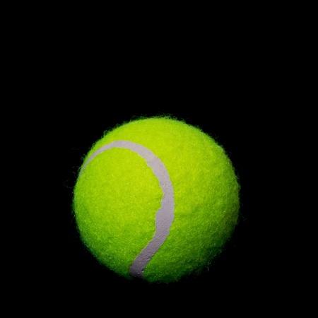 Tennis ball on a black background photo