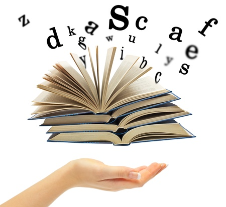 Hand and a book with departing letters on a white background
