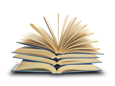 Pile of books with one book open on white background