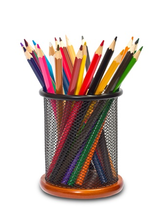 Colorful pencils in holder on white background photo