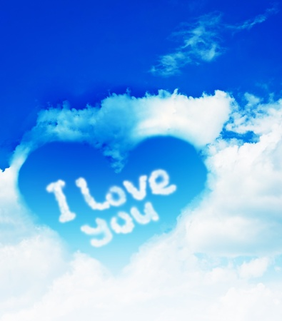 Heart made from cloud in the blue sky photo
