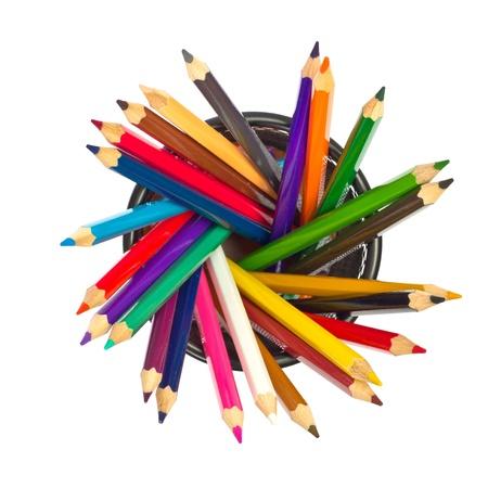 trompo de madera: L�pices de colores en la parte superior titular de vista sobre un fondo blanco Foto de archivo