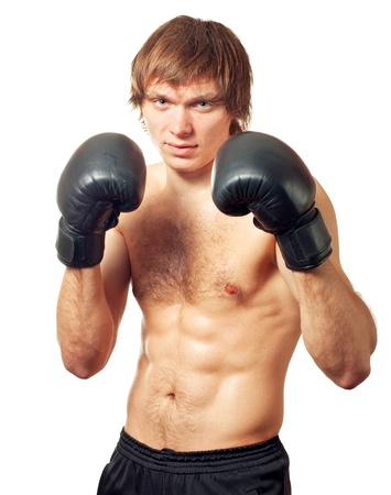 pugilist: Young caucasian man boxer with black boxing gloves on white background.
