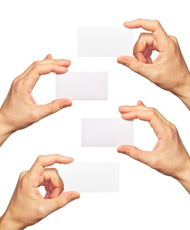 Business cards in hands on white background photo