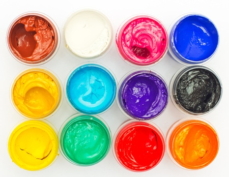 colored dye: Open banks of a paint with different colours Stock Photo
