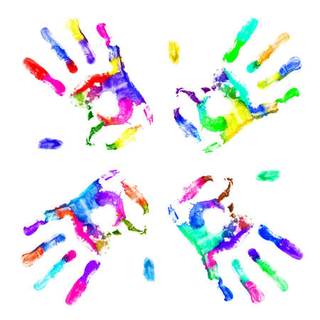 Multicolored hands print on white background photo