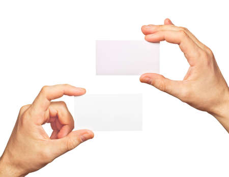 Business card in hands on white background photo