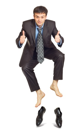 office shoes: Jumping businessman isolated on white