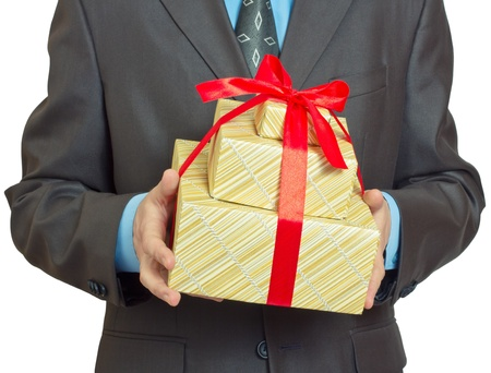 Businessman present gift box with red ribbon bow, front view, isolated over white background photo