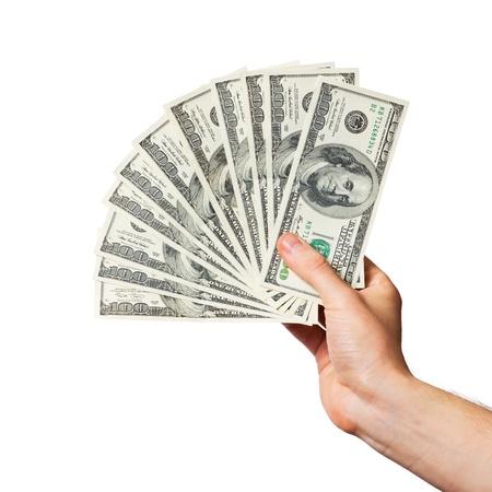 Men's hand holds a fan of dollars on white background Standard-Bild