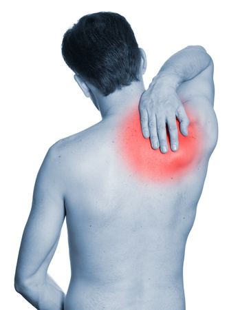 Rear view of a young man holding her neck in pain. Isolated on white background. Monochrome photo with red photo