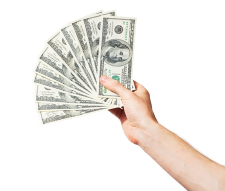 money in hand: Mens hand holds a fan of dollars on white background