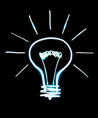 Light bulb isolated on black. Drawn frozen light photo