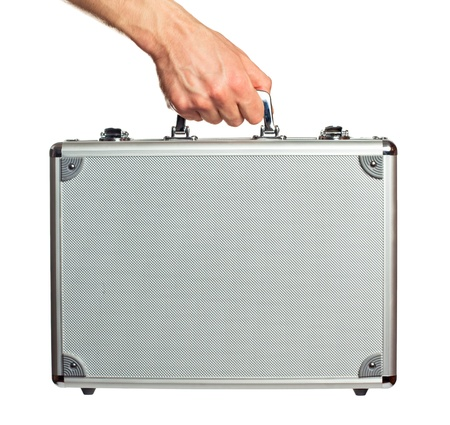 Silver metal briefcase in hand  Isolated on white Stock Photo - 12935566