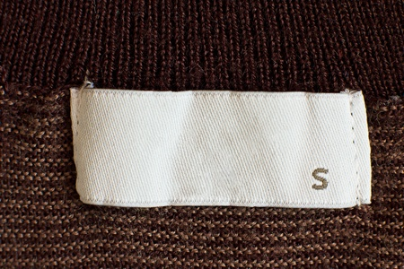 brown clothes: Macro of s size clothing label