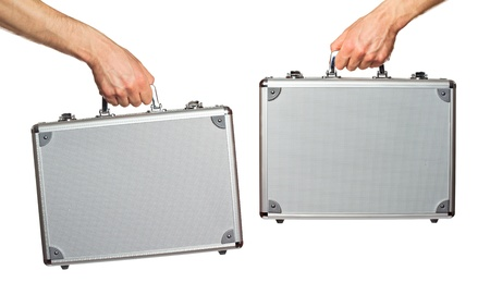 Silver metal briefcase in hands. Isolated on white Stock Photo - 13197876