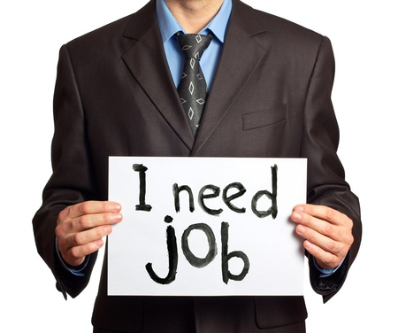 Businessman holding sign I need job photo