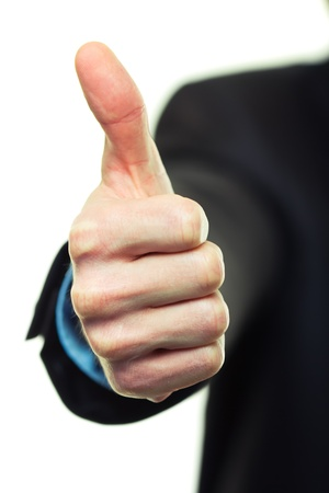 Business man hand with thumb up on white background photo