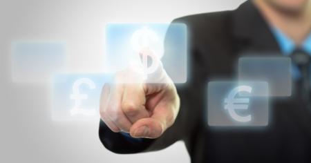 Businessman hand pressing virtual dollar sign button photo