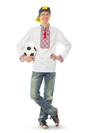 Ukrainian man in the national shirt with a ball on a white background photo