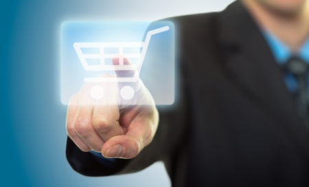 technology deal: Man hand pressing shopping cart icon Stock Photo