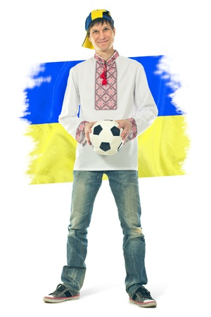 Ukrainian man in the national shirt with a ball and flag on a white background photo