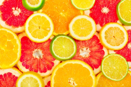 Mixed citrus fruit as background photo