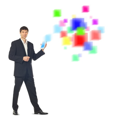 Young businessman using a Tablet Computer and a futuristic digital depiction of social media over white background photo