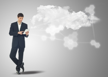 Businessman with touch screen Internet Tablet and the cloud computing concept and business network photo