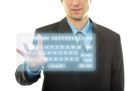 Businessman Hand pushing a button on a virtual keyboard Stock Photo - 14656010