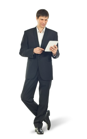 businessman standing: Young businessman using a Tablet computer over white background