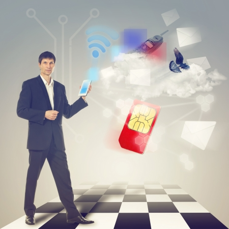Businessman using communications device with touch screen with email, sms, cloud service and other communications symbol photo