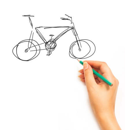 hand drawing: Womans Hand draws a bicycle isolated on white background