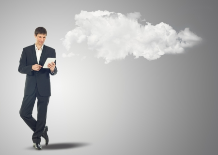 maybe: Businessman with touch screen Internet Tablet and the clouds. Maybe will used as concept cloud service