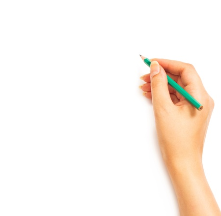 Womans hand holding a pencil on a white white background photo