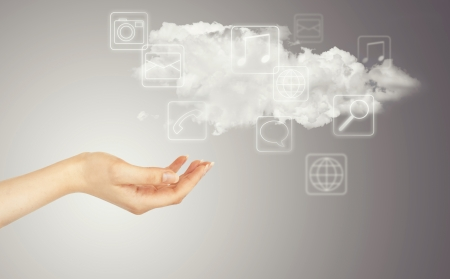 virtual assistant: Hand, cloud and multimedia icons. Cloud computing concept - world wide data sharing and communication